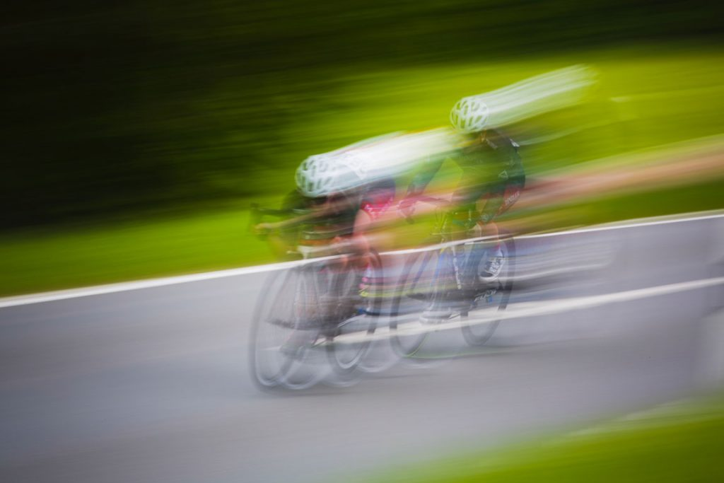blurred photo of a cyclist speeding
