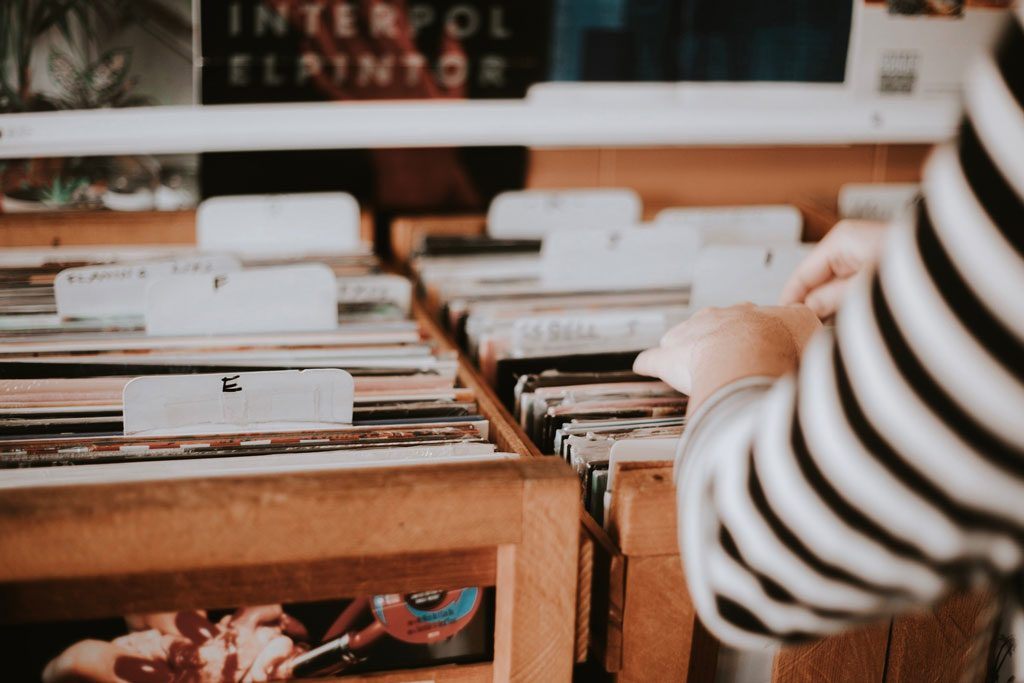 person browsing vinyl shelves