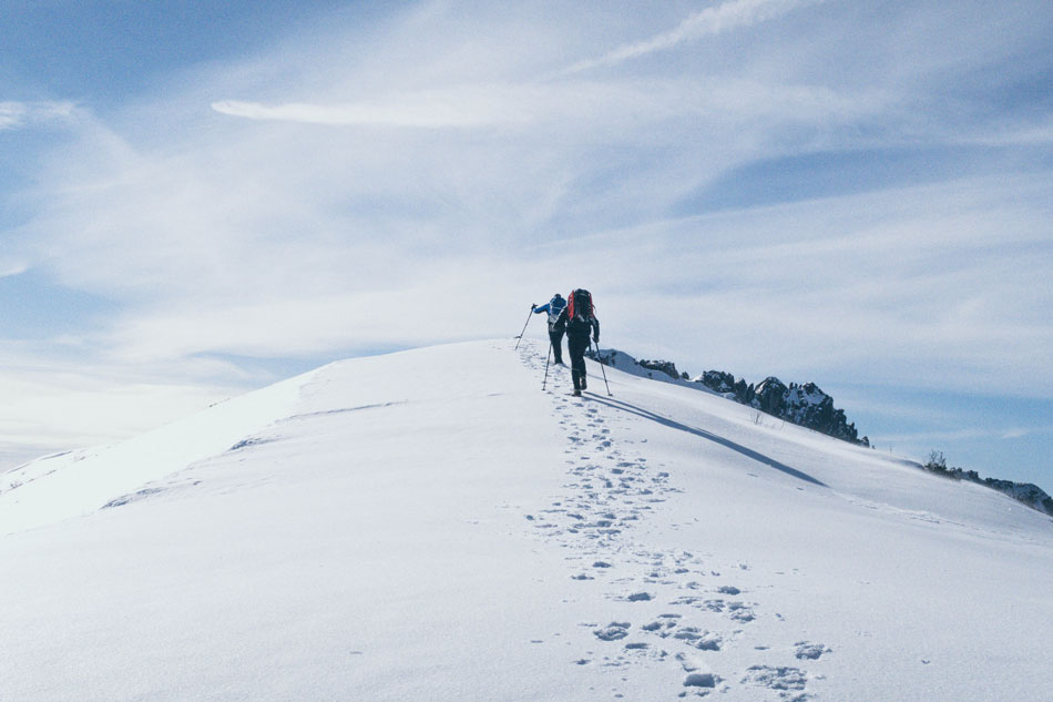 group of mountaineers climbing a snowy mountain