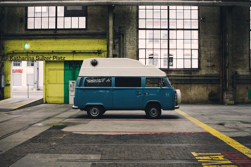 blue van in a big garage