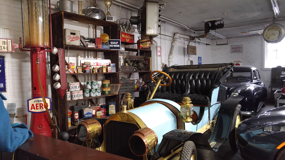 old car in an old gas station