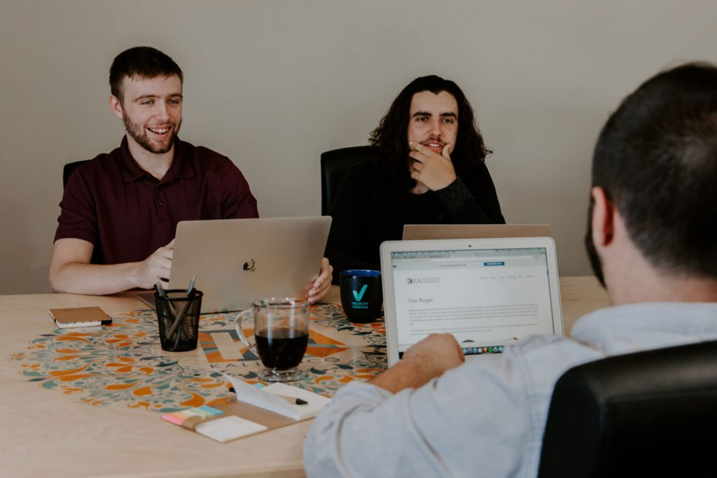 three product managers working