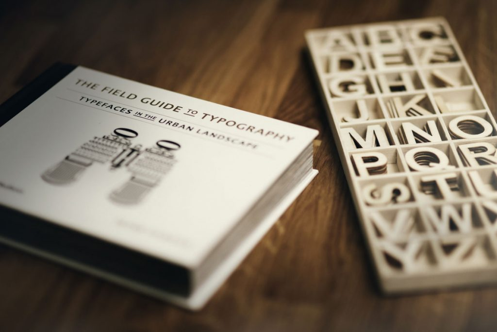 typography book next to printed letters