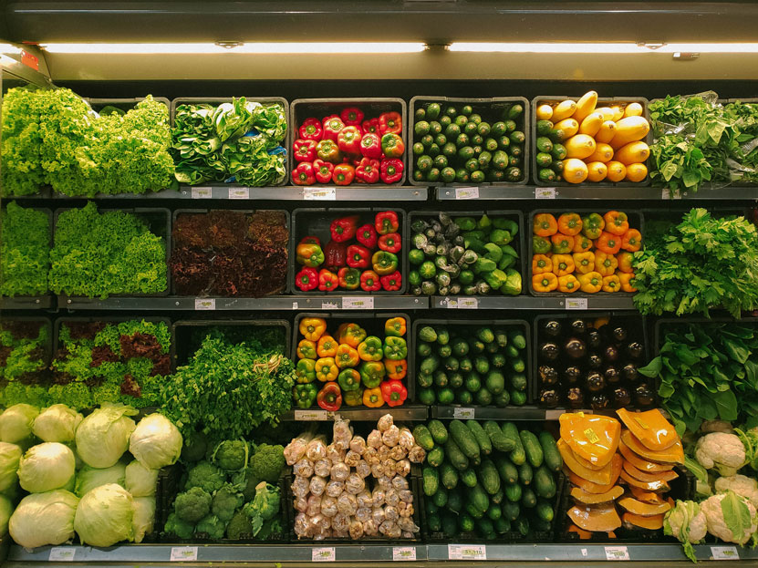 supermarket aisle with fruit and vegetables