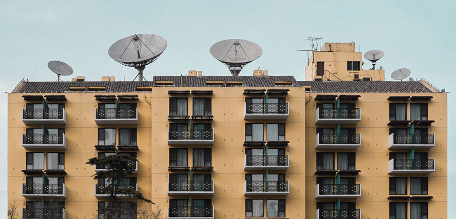 apartment building with antennae on top