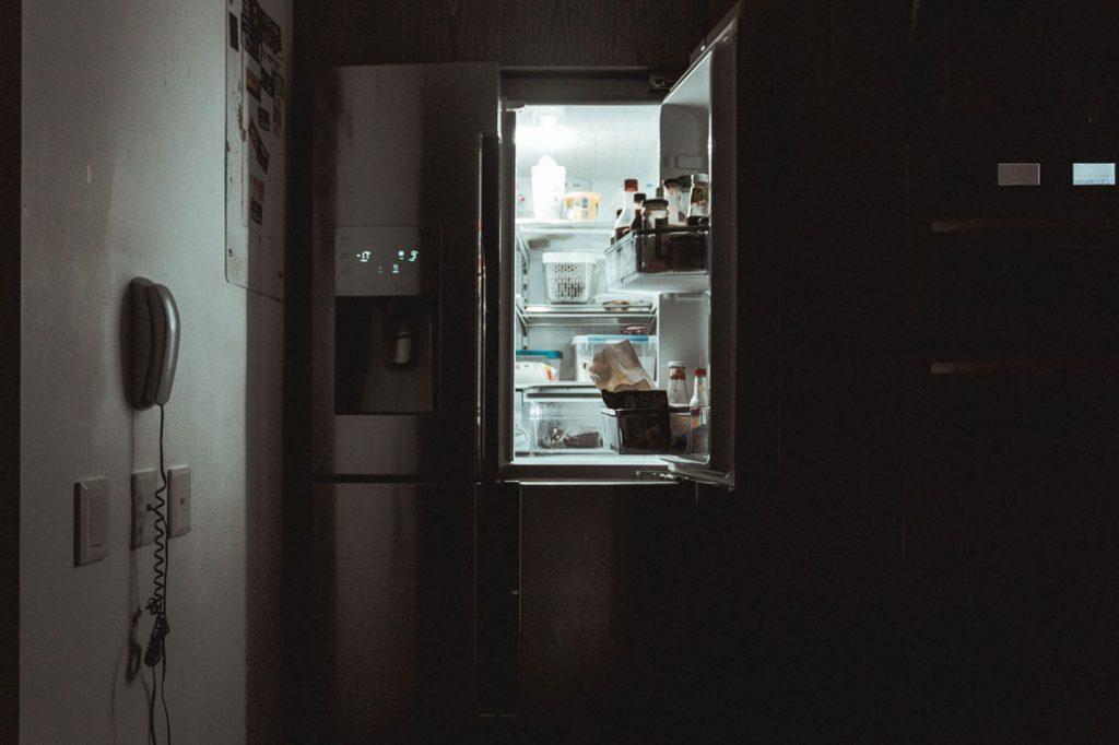 open fridge in a dark room