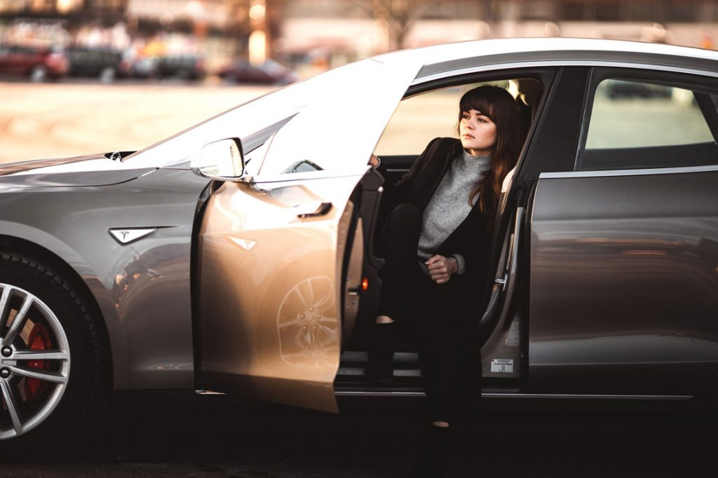 businesswoman leaving her car