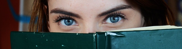 girls eyes and a book