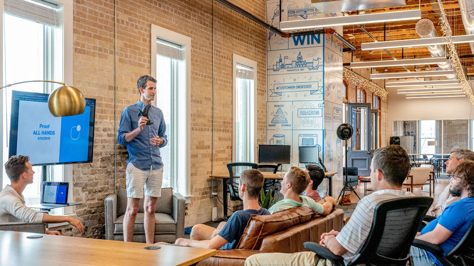 man talking to an audience in a coworking space