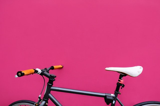 bike with a bright pink background