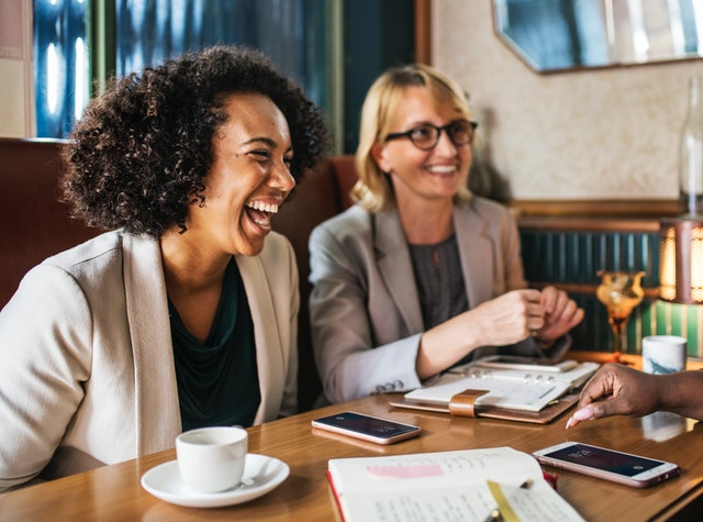 Women having a coffee and laughing