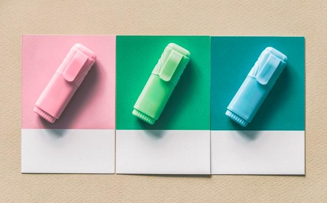 three coloured pens
