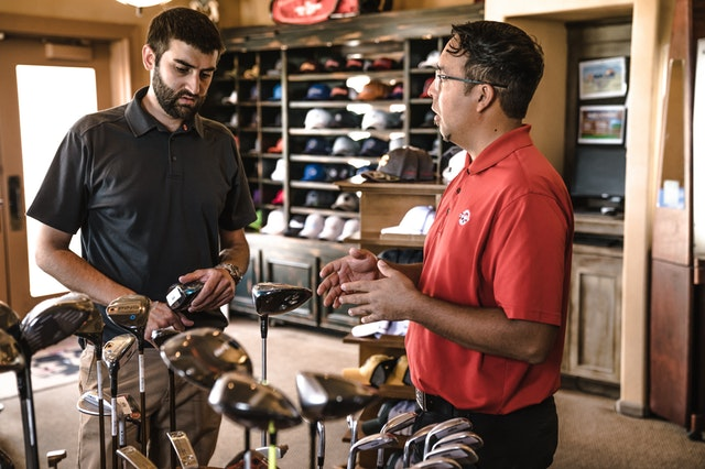 men in a golf products shop