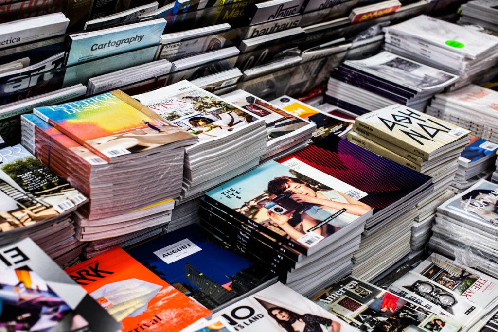 many stacks of different magazines