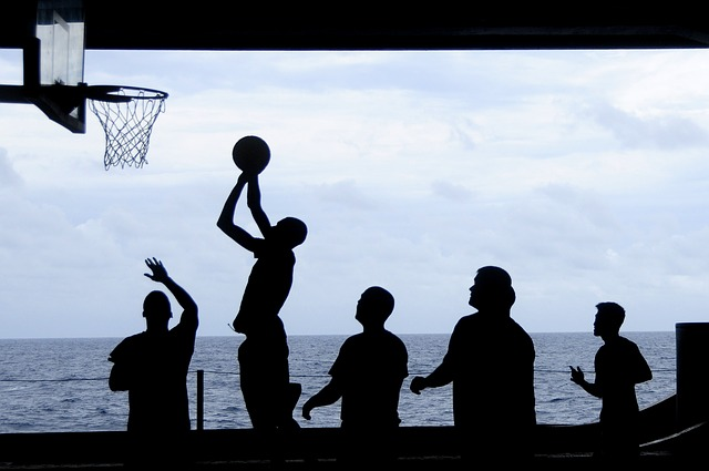 team playing basketball by the sea