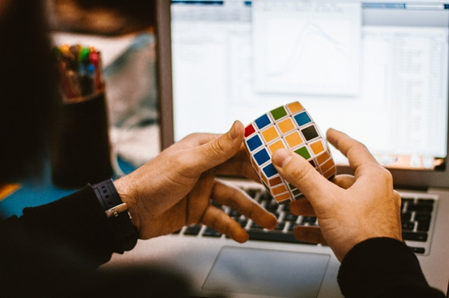 Hands playing with a rubiks cube