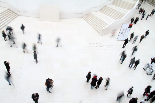 people walking on marble floor