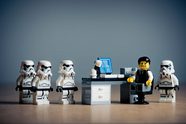 lego stormtroopers surrounding a nervous employee