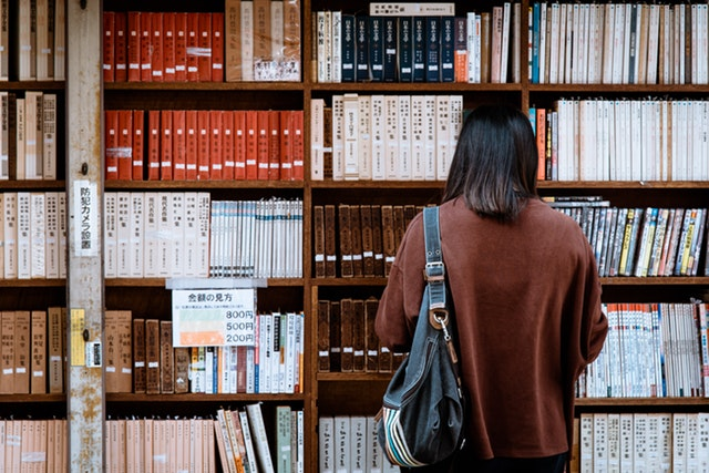 woman in front of bookcase
