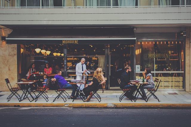 Customers outside of a bar
