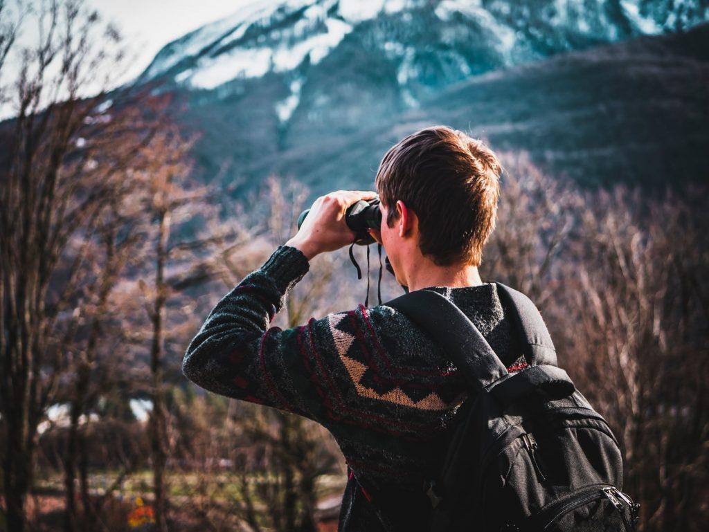 Man with discovery binoculars