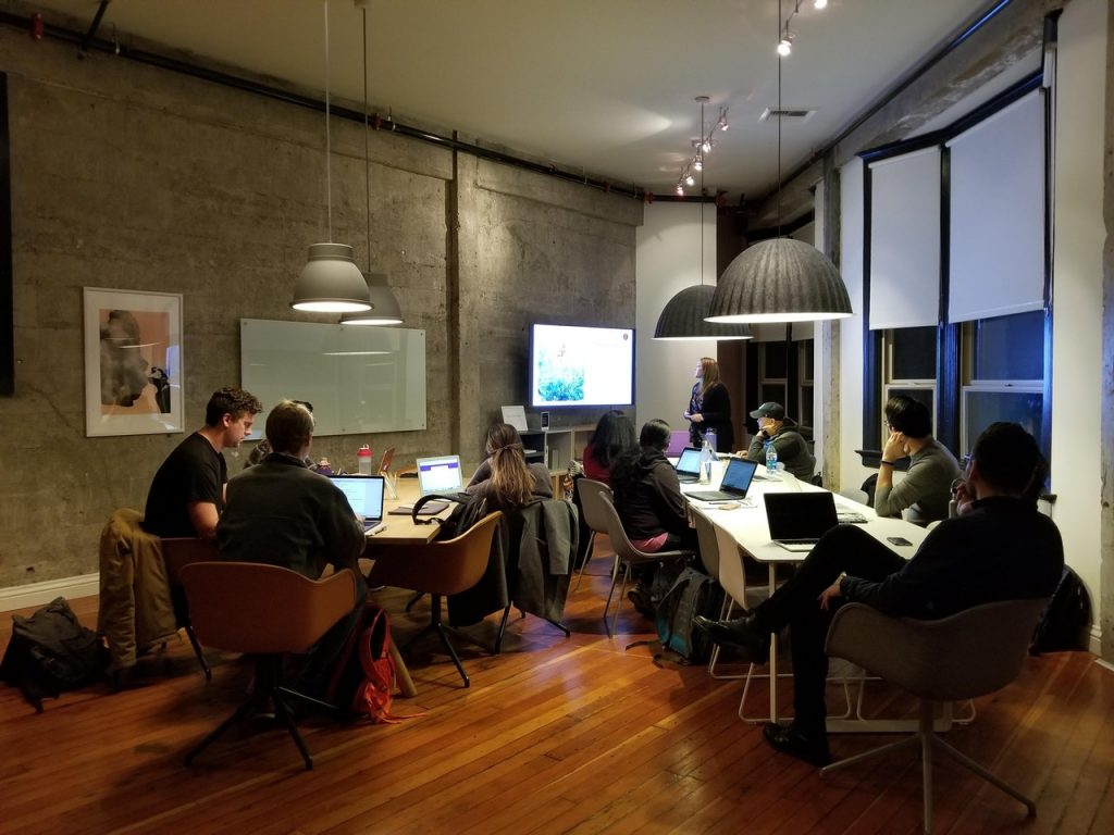 people sitting in a room working together