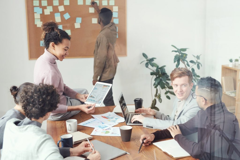 people in a meeting setting targets and KPIs