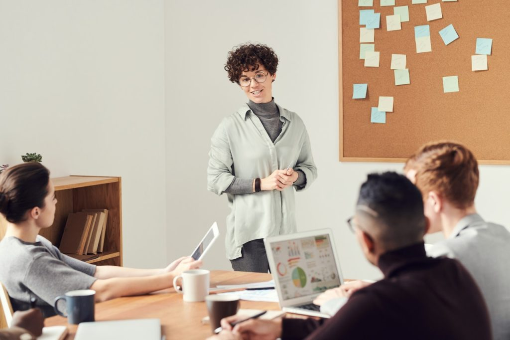 person giving presentation in meeting