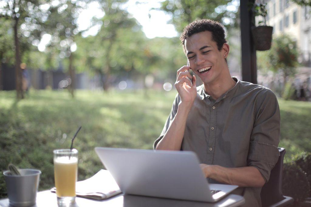 guy smiling while using laptop