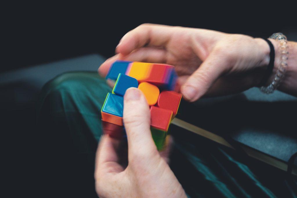 hands building rubix cube