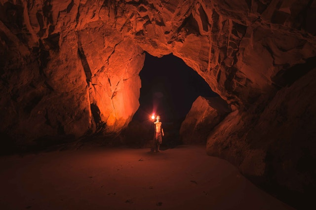 Man standing in cave