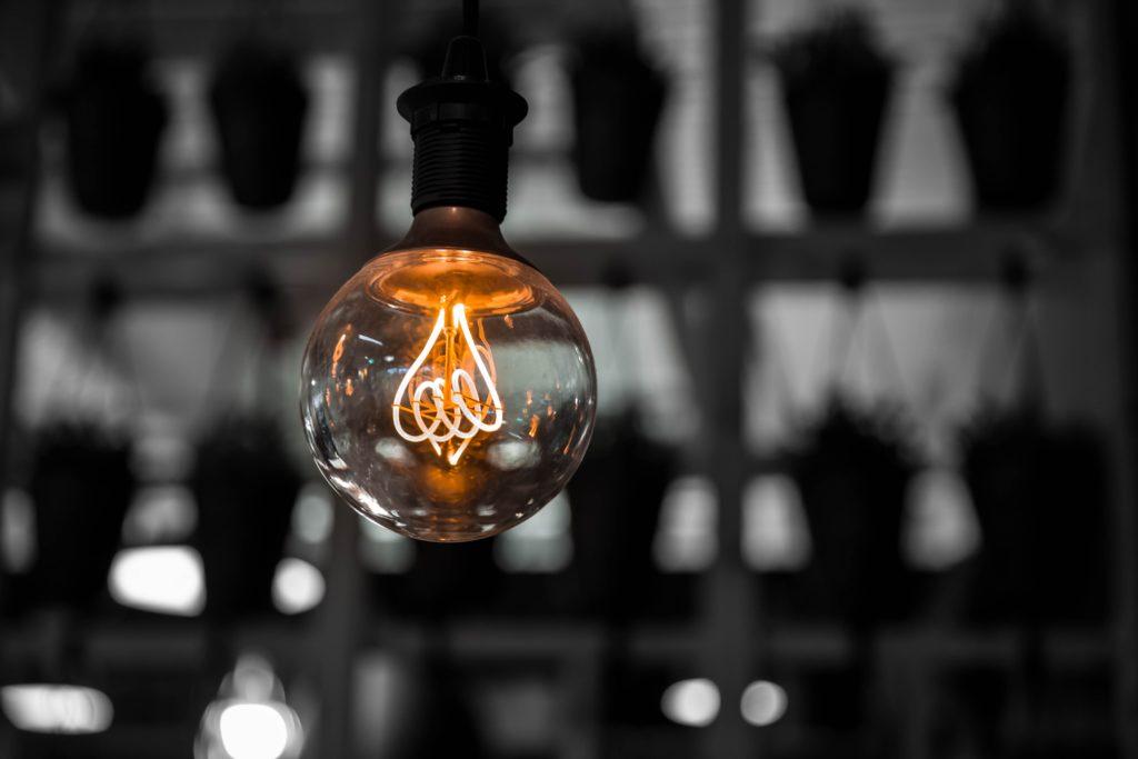 a single lightbulb on in a dark room