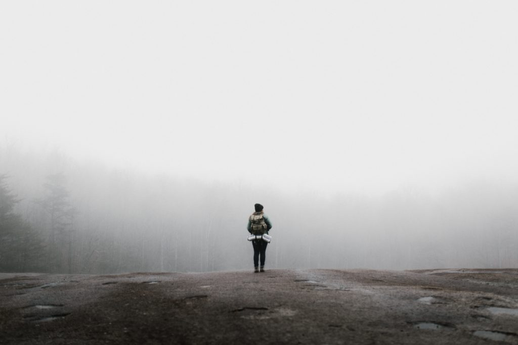 person standing alone in the forest
