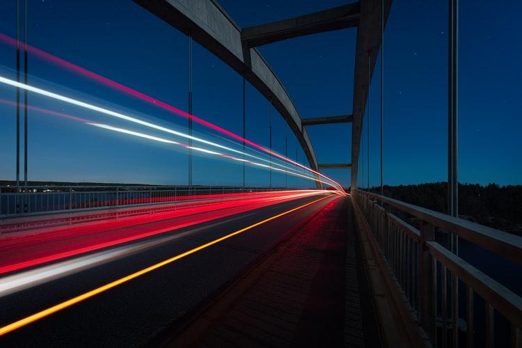 highway car lights on bridge