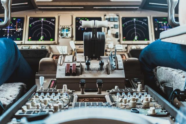 A pilot and copilot in a cockpit