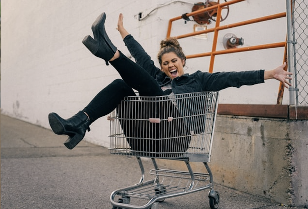 woman smiling in shopping cart