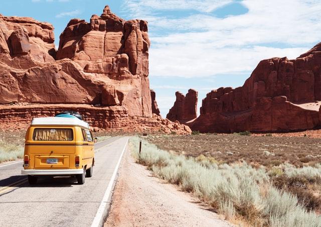 Van driving down desert road