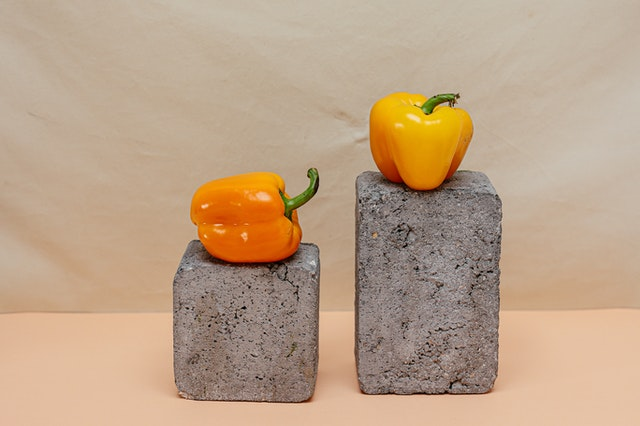 bell peppers on stone blocks
