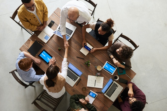 birds eye view of people meeting around a table