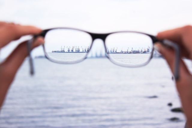 view through glasses of ships on the ocean in the distance