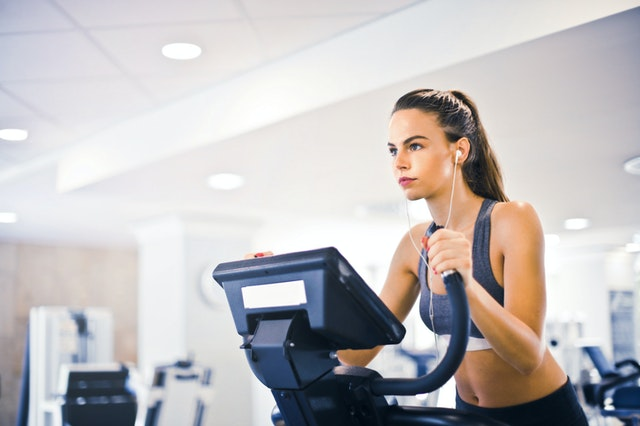 woman on elliptical staring into distance