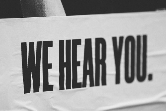 """A sign that says """"We hear you"""""""