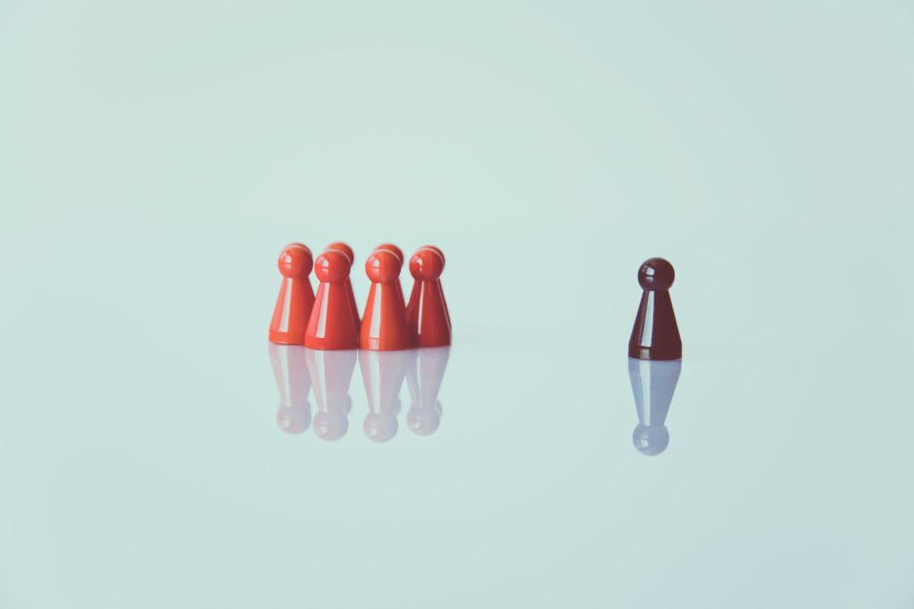 standing out from the crowd with chess piece metaphor