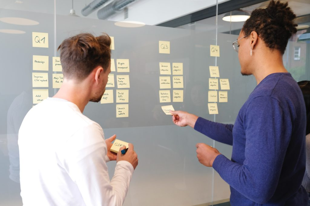 Two people working together on a presentation