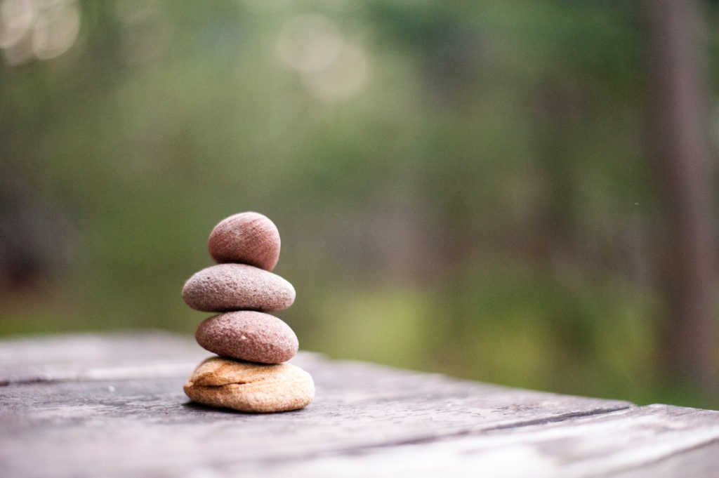 smooth rocks stacked on top of each other in a zen tower
