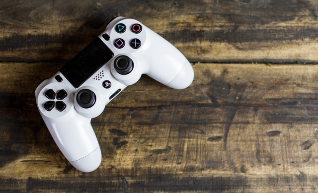 birds eye view of white play station gaming control